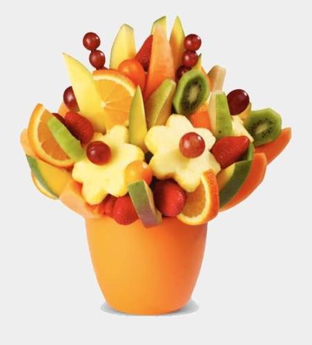 Фруктова композиція з ківі, ананасу, апельсинів і винограду